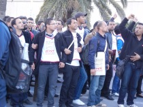 Tunisian opposition in verbal confrontation with government forces, WSF 2013; photo by Frances Hasso