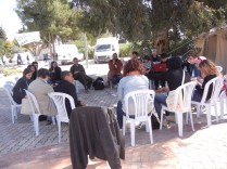 "U.S. Occupy activists (""the Global Square"" group) strategize in the morning about the use of global media platforms in Zone C; WSF, Tunis; 29 March 2013; photo by Frances Hasso"