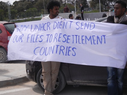 One of many banners, this one complaining about UNHCR not assisting in resettlement of refugees from Libya; 30 March 2013; WSF, Tunis; photo by Frances Hasso