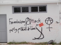 "Anarchist-feminist signs; ""The downfall of the regime is necessary"" (Arabic); 30 March 2013; Manar Univ.; photo by Frances Hasso"