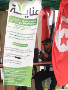 "A state organization nestled among the anarchists and focused on ""family promotion""; 30 March 2013; Manar University; WSF, Tunis; photo by Frances Hasso"