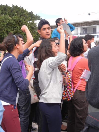 Young Tunisian women chanting against Ennahdha supporters; 30 March 2013; WSF Tunisia; Photo by Frances Hasso